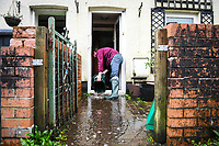 Flooding effected the villages of Aberdulais and Tonna in the Neath Valley after Storm Callum brought heavy rain and wind to the area cuasing the River Neath to reach bursting point. <br /> Luke Springthorpe clears water from his home at Canal Side, Neath. Saturday 13 October 2018