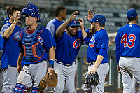 Yonathan Perlaza (15) congratulates AZL Cubs relief pitcher Jeffrey Passantino (96) as he walks to the dugout between innings during Game Three of the Arizona League Championship Series against the AZL Giants on September 7, 2017 at Scottsdale Stadium in Scottsdale, Arizona. AZL Cubs defeated the AZL Giants 13-3 to win the series two games to one. (Zachary Lucy/Four Seam Images)
