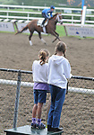 16 August 2008: Two visitors watch morning workouts at Saratoga Race Course in Saratoga Springs, New York.