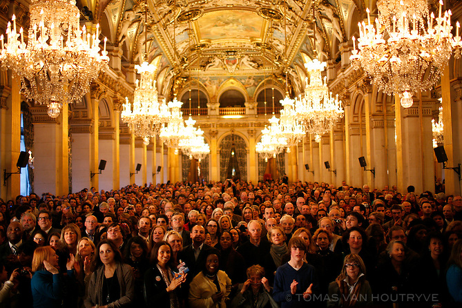 Supporters of Barack Obama watch a screen with live coverage of the U.S. presidential inauguration inside the Hotel de Ville (City Hall) of Paris, France.