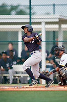 GCL Yankees East right fielder Jesus Severino (33) follows through on a swing during the first game of a doubleheader against the GCL Pirates on July 31, 2018 at Pirate City Complex in Bradenton, Florida.  GCL Yankees East defeated GCL Pirates 2-0.  (Mike Janes/Four Seam Images)