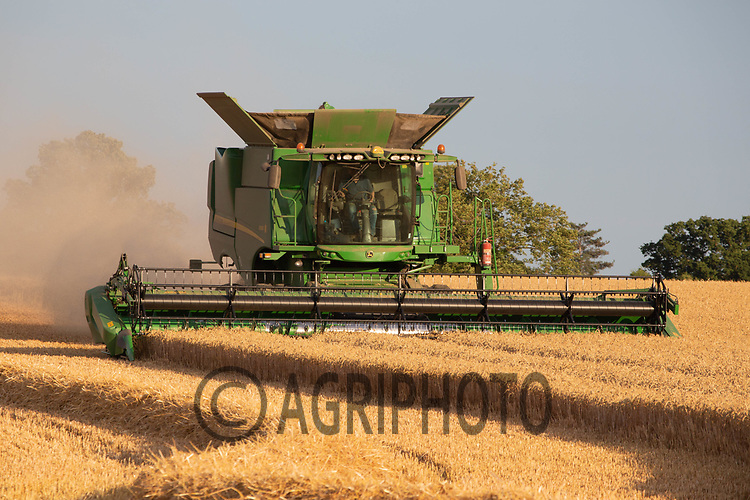 John Deere combine harvesting Winter wheat in Lincolnshire<br /> ©Tim Scrivener Photographer 07850 303986<br />      ....Covering Agriculture In The UK....