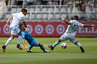 LOS ANGELES, CA - MAY 29: Maximiliano Moralez #10 of NYCFC pushes a ball past Eddie Segura #4 of LAFC during a game between New York City FC and Los Angeles FC at Banc of California Stadium on May 29, 2021 in Los Angeles, California.
