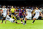 Gabriel Armando de Abreu of Valencia CF (L) trips up with Lionel Messi of FC Barcelona (C) during their La Liga 2018-19 match between Valencia CF and FC Barcelona at Estadio de Mestalla on October 07 2018 in Valencia, Spain. Photo by Maria Jose Segovia Carmona / Power Sport Images