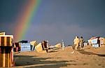 Germany, Lower Saxony, East Frisian Island, Baltrum: storm front at the North Sea beach with rainbow | Deutschland, Niedersachsen, Ostfriesische Insel, Baltrum: Gewitterstimmung am Nordseestrand mit Regenbogen