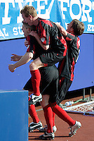 The MetroStars' Chris Leitch and Michael Bradley celebrate John Wolyniec's 82nd minute goal putting the MetroStars up 2-1. The MetroStars and the New England Revolution played to a 2 - 2 tie at Giant's Stadium, East Rutherford, NJ, on Saturday May 21, 2005.