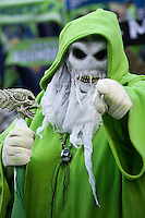 A fan dressed for Halloween has a warning for the visiting team before the first game of the 2010 MLS Playoffs between the Seattle Sounders and the Los Angeles Galaxy at the XBox 360 Pitch at Quest Field in Seattle, WA on October 31, 2010. The Galaxy defeated the Sounders 1-0.
