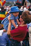 A mother playing with toddler daughter at an outdoor event, Estes Park, CO