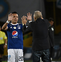 BOGOTA - COLOMBIA - 18 – 02 - 2018: Juan Guilermo Dominguez (Izq.), jugador de Millonarios, celebra con Miguel Angel Russo, (Der.) técnico de Millonarios el gol anotado a Atletico Nacional, durante partido de la fecha 4 entre Millonarios y Atletico Nacional, por la Liga Aguila I 2018, jugado en el estadio Nemesio Camacho El Campin de la ciudad de Bogota. / Juan Guilermo Dominguez (L),  player of Millonarios celebrates with Miguel Angel Russo (R) coach of Milonarios, the scored goal to Atletico Nacional,  during a match of the 4th date between Millonarios and Atletico Nacional,  for the Liga Aguila I 2018 played at the Nemesio Camacho El Campin Stadium in Bogota city, Photo: VizzorImage / Luis Ramirez / Staff.