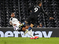 13th March 2021, Craven Cottage, London, England;  Manchester Citys Gabriel Jesus is tackled by Fulhams Ivan Cavaleiro during the English Premier League match between Fulham and Manchester City at Craven Cottage in London