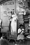 Managua, Nicaragua. Madonna and Christ child  outside a small shop in the city centre. 1973 1970s
