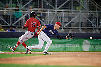 Binghamton Rumble Ponies third baseman Andrew Ely (6) reaches out to receive a throw as Deiner Lopez (24) runs to third base during a game against the Portland Sea Dogs on August 31, 2018 at NYSEG Stadium in Binghamton, New York.  Portland defeated Binghamton 4-1.  (Mike Janes/Four Seam Images)