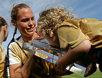 USA's Christie Rampone and her daughter Rylie Cate celebrates with the trophy after the finals. The United States defeated Denmark 2-1 during the finals of the Algarve Cup 2008 at Municipal Stadium in Vila Real de San Antonio, Portugal on March 12, 2008. Paulo Cordeiro/isiphotos.com..