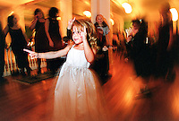 "Flowergirl, Gena Buza, 3, of Cazenovia, NY, dances at the recepetion after Darcy Stucker and Michael Buza's wedding ceremony.  Darcy chose to have her wedding in Baldwinsville's Mohegan Manor, a restored building which used to be the Goodfellows Club.  ""The first time I saw it, I just thought is was beautiful,"" says Stucker of the Manor which among its attributes, has a beautiful ballroom, sweeping staircase and spacious dining room. Julia cumes 2000"