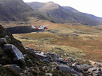 Pictured: Members of the Llanberis Mountain and Ogwen Valley Mountain Rescue teams, help free up a woman whose leg got trapped in a crack in north Wales, UK.<br /> Re: A trapped climber was rescued using washing-up liquid after her leg became stuck in a crack on a cliff in Gwynedd.<br /> The woman, in her 50s, got stuck after slipping while walking on Gribin Facet, above the Ogwen Valley.<br /> About 16 volunteers from Llanberis and Ogwen Valley Mountain Rescue team were called after the woman's husband was unable to free her.<br /> They put washing-up liquid around her knee and used ropes to pull her free of the crack.<br /> The woman was airlifted to hospital for a check up.