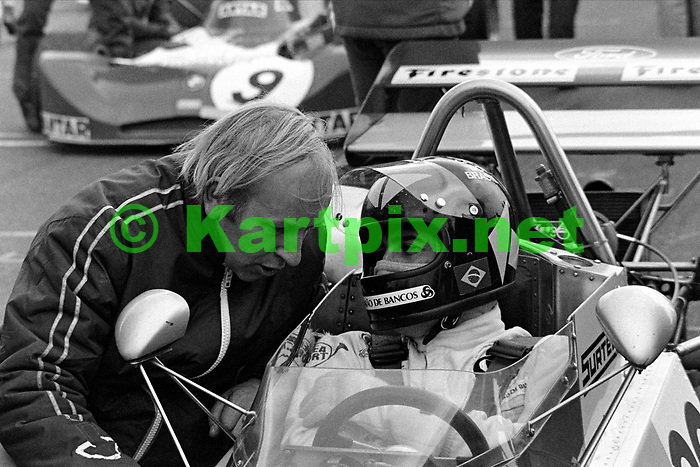 """John Surtees chatting with Carlos Pace on the grid at Thruxton in 1973.<br /> <br /> <br /> Esso Uniflo B.A.R.C. """"200"""" 1973<br /> Jochen Rindt Memorial Trophy<br /> European Championship for F2 Drivers, Round 3"""