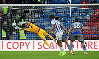 Lincoln City's Grant Smith saves a long-range deflected shot by Huddersfield Town's Juninho Bacuna<br /> <br /> Photographer Chris Vaughan/CameraSport<br /> <br /> The Carabao Cup First Round - Huddersfield Town v Lincoln City - Tuesday 13th August 2019 - John Smith's Stadium - Huddersfield<br />  <br /> World Copyright © 2019 CameraSport. All rights reserved. 43 Linden Ave. Countesthorpe. Leicester. England. LE8 5PG - Tel: +44 (0) 116 277 4147 - admin@camerasport.com - www.camerasport.com