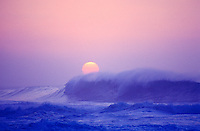Huge winter surf as seen from Kee Beach, Haena, Kauai north shore, at sunset.
