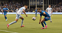 KANSAS CITY, KS - MAY 29: Daniel Salloi #20 of Sporting KC tries to get past Adam Lundkvist #3 of Houston Dynamo FC during a game between Houston Dynamo and Sporting Kansas City at Children's Mercy Park on May 29, 2021 in Kansas City, Kansas.