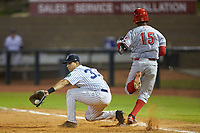 Mickey Gasper (33) of the Pulaski Yankees stretches for a throw as Jonathan Willems (15) of the Greeneville Reds hustles towards first base at Calfee Park on June 23, 2018 in Pulaski, Virginia. The Reds defeated the Yankees 6-5.  (Brian Westerholt/Four Seam Images)