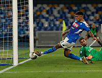 Giovanni Di Lorenzo of Napoli shoots and scores during the  italian serie a soccer match,  SSC Napoli - AC Milan       at  the San  Paolo   stadium in Naples  Italy , July 12, 2020