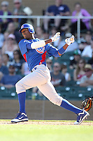 Junior Lake of the Chicago Cubs hits a pinch single against the Arizona Diamondbacks in a spring training game at Salt River Fields on March 13, 2011 in Scottsdale, Arizona. .Photo by:  Bill Mitchell/Four Seam Images.