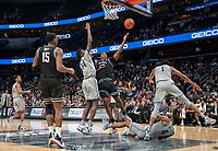 WASHINGTON, DC - FEBRUARY 19: Kalif Young #13 of Providence sends up a shot defended by Qudus Wahab #34 of Georgetown during a game between Providence and Georgetown at Capital One Arena on February 19, 2020 in Washington, DC.