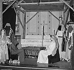 Pittsburgh PA: View of the Christmas play; the birth of baby Jesus, at the First Luthern Church on Grant Street in Pittsburgh - 1958.  Members of the congregation donned period clothing the recreate Christmas night 1958 years earlier.  Mary and Joseph in front of the manager with gifts from the wise men