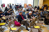 People fill out ballots registering their participation in the Portland Democratic City Committee town caucus in the East End School cafeteria in Portland, Maine, USA, on March 3, 2014. The town caucus had speeches from various other local candidates and also served to choose delegates for the 2014 Maine State Democratic Caucus.