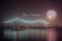 Fireworks burst over the Newport Bridge