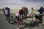 Radioshack-Nissan Trek rider Fabian Cancellara (SUI) and Farnese Vini-Selle Italia rider Andrea Guardini (ITA) sign on before the start of Stage 4 of the 2012 Tour of Qatar from Al Thakhira to Madinat Al Shamal, Qatar. 8th February 2012.<br /> (Photo Eoin Clarke/Newsfile)