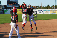 Batavia Muckdogs Walker Olis (3) chest bumps Alex Jones (55) as Eric Gutierrez (43) looks on after a walk off hit during the second game of a doubleheader against the Auburn Doubledays on September 4, 2016 at Dwyer Stadium in Batavia, New York.  Batavia defeated Auburn 6-5. (Mike Janes/Four Seam Images)