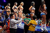A man uses his camera to photograph models before the start of a Lucha Libre match. Lucha Libre is a style of wrestling started in Mexico in 1933. The name means Free Fight, and matches tend to be focussed on spectacle and theatre with fans cheering for their favourite characters, who wear masks while jumping from the ropes, flipping opponents, and occasionally crashing into the crowd..©Jacob Silberberg/Panos/Felix Features.
