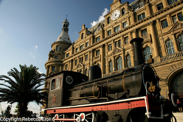 Haydarpasa train station, Istanbul, Turkey, with an old steam engine from the Orient Express on display in front. Trains went from the station on the eastern leg of the Orient Express to Baghdad.