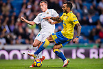 Lucas Vazquez of Real Madrid (L) fights for the ball with Michel Macedo Rocha Machado of UD Las Palmas (R) during the La Liga 2017-18 match between Real Madrid and UD Las Palmas at Estadio Santiago Bernabeu on November 05 2017 in Madrid, Spain. Photo by Diego Gonzalez / Power Sport Images