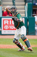 Yasmani Grandal #24 of the Miami Hurricanes makes a throw to first base against the Boston College Eagles at the 2010 ACC Baseball Tournament at NewBridge Bank Park May 27, 2010, in Greensboro, North Carolina.  The Eagles defeated the Hurricanes 12-10 in 10 innings.  Photo by Brian Westerholt / Four Seam Images