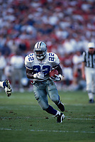 SAN FRANCISCO, CA:  Emmitt Smith of the Dallas Cowboys runs with the football during the game against the San Francisco 49ers at Candlestick Park in San Francisco, California on November 12, 1995. (Photo by Brad Mangin)