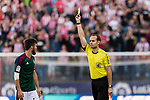 Referee Mario Melero lopez shows a yellow card during the La Liga match between Atletico de Madrid vs Osasuna at Estadio Vicente Calderon on 15 April 2017 in Madrid, Spain. Photo by Diego Gonzalez Souto / Power Sport Images