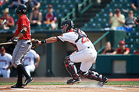 Rochester Red Wings catcher Eric Fryer (22) tags Gustavo Nunez (12) to complete the strikeout during a game against the Indianapolis Indians on June 10, 2015 at Frontier Field in Rochester, New York.  Indianapolis defeated Rochester 5-3.  (Mike Janes/Four Seam Images)