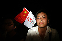 CHINA. Beijing. Members of the Chinese public whilst watching the opening ceremony of the Beijing Summer Olympics. 2008