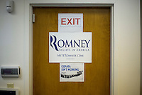 A sign critical of President Obama hangs on a door in the Mitt  Romney New Hampshire campaign headquarters in Manchester, New Hampshire, on Jan. 7, 2012. Romney is seeking the 2012 Republican presidential nomination.