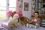 Her Serene Highness Elisabeth de Croy, having tea and with her dogs. France 1980s.