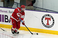 WORCESTER, MA - FEBRUARY 08: Alex Allan #2 of Boston University looks to pass during a game between Boston University and College of the Holy Cross at Hart Center Rink on February 08, 2020 in Worcester, Massachusetts.