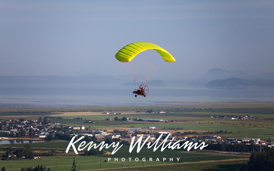 Yellow Powered Parachute in Flight over Skagit Valley, Arlington, Washington State, WA, America, USA.