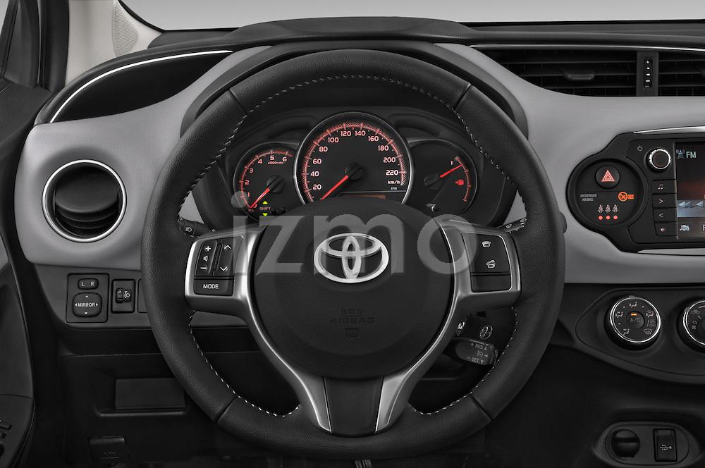 Car pictures of steering wheel view of a 2015 Toyota YARIS Dynamic 5 Door Hatchback 2WD Steering Wheel