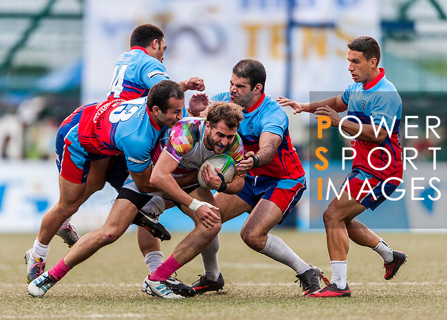 A-Trade Overseas Old Boys vs Gavekal Mongrels during day 1 of the 2014 GFI HKFC Tens at the Hong Kong Football Club on 26 March 2014. Photo by Juan Flor / Power Sport Images