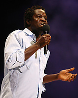 French-Canadian artist Boucar Diouf performs during the St-Jean-Baptist show on the Plains of Abraham in Quebec city June 23, 2009.