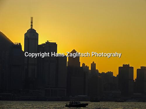 Modern skyline of Hongkongs Central District at sunset
