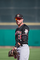 Kyle Parker (11) of the Albuquerque Isotopes on defense against the Salt Lake Bees in Pacific Coast League action at Smith's Ballpark on June 8, 2015 in Salt Lake City, Utah.  (Stephen Smith/Four Seam Images)