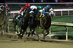 Agastache with Jon Court (blue cap) duels with Chris Got Even and  Robby Albarado to win the 9th race at Churchill Downs. 06.19.2009